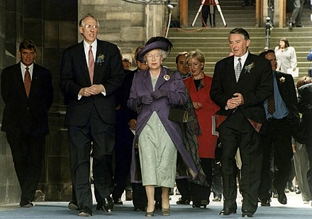 Queen Elizabeth II at the opening of the Scottish Parliament on 1 July 1999 alongside then First Minister of Scotland Donald Dewar and then Presiding Officer Lord Steel of Aikwood Her Majesty Queen Elizabeth II at the opening of the Scottish Parliament.jpg