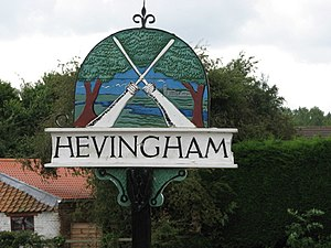 Hevingham - The village sign in 2007. It depicts crossed brooms, historically broom-making was a staple industry in Hevingham.