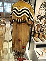 Hide dress with striped yoke dipping to frame deer tail, Blackfoot, Alberta or Montana, c. 1890 - Royal Ontario Museum - DSC00327.JPG