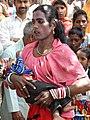 Hijra Dancer with Child - Lumbini Pilgrim's Park - Lumbini - Nepal - 01 (13867814095).jpg