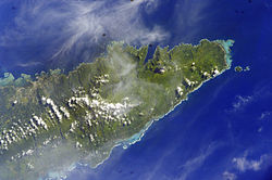 Satellite image of eastern side of Upolu island with tiny islands off the coast. (NASA photo, 2006)