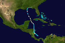 Map of a track starting in the southern Caribbean Sea and extending northward into the Gulf of Mexico and the United States Gulf Coast. Points along the track indicate storm intensity by color and classification by shape.