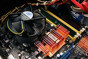 The heatsinks from an Intel quad-core processor and an Asus P5E-VM motherboard