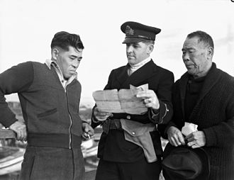 Japanese Canadian internment - A Royal Canadian Navy officer questions Japanese-Canadian fishermen while confiscating their boat.