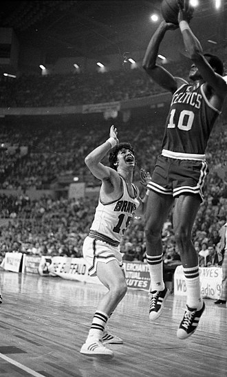Jo Jo White - White trying to score while being marked by Ernie DiGregorio.