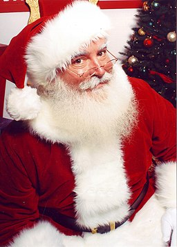 Jonathan G Meath portrays Santa Claus