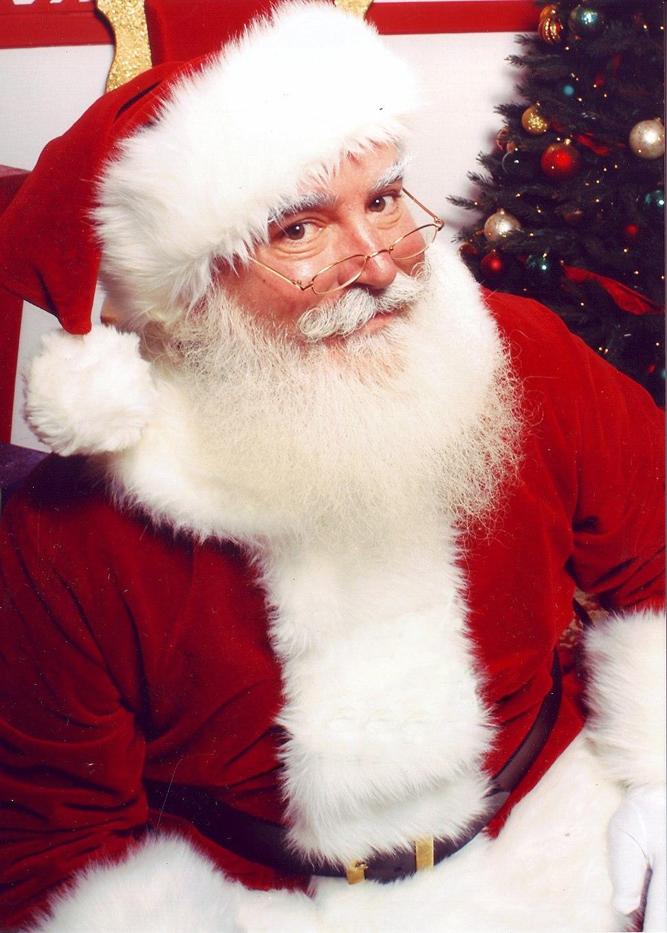 Jonathan G Meath portrays Santa Claus