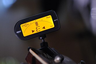 Electronic tuner - A clip-on tuner attaches to the instrument and senses the vibrations from the instrument, even in a noisy environment.