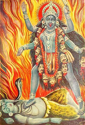 Goddess movement - Modern, western depiction of the Hindu goddess Kali, shown standing atop Shiva, wearing a necklace of severed heads, in front of a fiery background