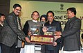 Kamal Nath giving away the National Road Safety Award to the Himachal Road Transport Corporation, at the Valedictory Function of the National Road Safety Week 2011, in New Delhi on January 07, 2011.jpg