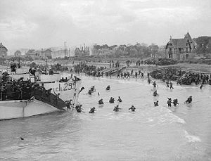 Battle of Le Mesnil-Patry - Canadian reserve troops disembark at 'Nan White' Beach at Bernières-sur-Mer.