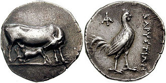 Carystus - Silver stater of Karystos, 313-265 BCE. Obverse: Cow and calf. Reverse: rooster, ΚΑΡΥΣΤΙΩΝ.