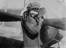 Lady standing jauntily in front of an aircraft