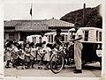 Kindergarten school children getting on tricycle school bus before the school building, at Keelung 1958.jpg