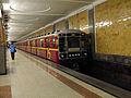 Krasnaya strela (Red arrow) train at Krasnoselskaya station (Метропоезд Красная cтрела на станции Красносельская) (5234111483).jpg