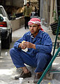 Laborer eating lunch, Al-Hamidiyah Souq, Damascus, Syria.jpg