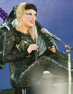 "Tik Tok - ""Tik Tok"" has commonly been compared to American singer Lady Gaga's (pictured) debut single, ""Just Dance"" for their similar subject matter."