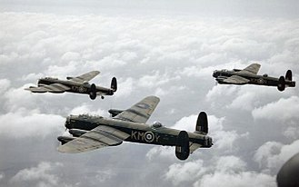 Operation Robinson - Three Lancasters of 44 Squadron flying in formation at altitude