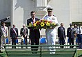 Laying a wreath 130816-N-EZ054-181.jpg