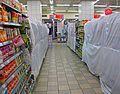 Leavened foods concealed behind plastic at Jerusalem supermarket during Passover.jpg