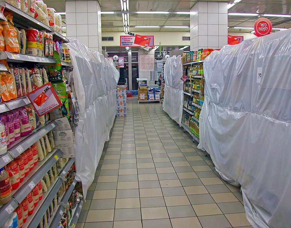 Leavened foods concealed behind plastic at Jerusalem supermarket during Passover