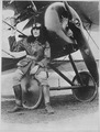 Lieutenant Earl Carroll, prominent composer, is now a full-fledged aviator in the U.S. Service. He is shown beside... - NARA - 533718.tif