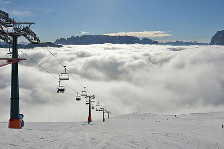 Chairlift and skiing on the mount Secëda in Val Gardena
