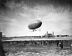 Lincoln Beachy and his dirigible above the Aeronautic Concourse at the Lewis and Clark Exposition, Portland, Oregon, 1905 (AL+CA 1869).jpg