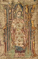 A bishop, possibly St. Peblig, blessing and wearing a mitre, and holding a crosier