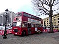 London 007 St Katharine Dock red bus shop (8387378276).jpg