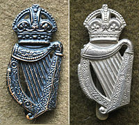 Cap badge variations between WW1 (Left) and WW2 (Right) London Irish Cap Badge Variations.jpg