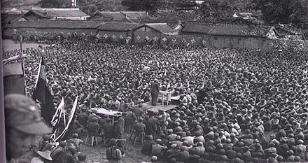 A Chinese Communist Party cadre-leader addresses survivors of the 1934-1935 Long March Long-march.jpg