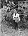 Louisa Boren Denny standing by rhododendron bush at Licton Springs, May 30, 1905 (LL 1163).jpg