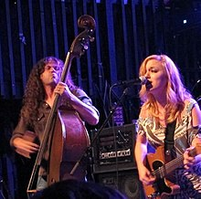 Lydia Loveless (right) with husband/bassist Ben Lamb (left) playing in Fort Collins, Colorado (2011)