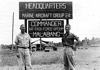Marine Aircraft Group 24 - Col Warren E. Sweetser, Jr., left, commanded MAG-24 in June 1945. His executive officer, LtCol John H. Earle, Jr., is on the right