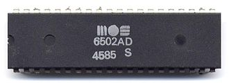MOS Technology 6502 - A MOS 6502 processor in a DIP-40 plastic package. The four-digit date code indicates it was made in the 45th week of 1985
