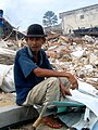Man looks over his Nias neighbourhood following the 2004 Indian Ocean Tsunami. Indonesia, 2005 (10698063893).jpg