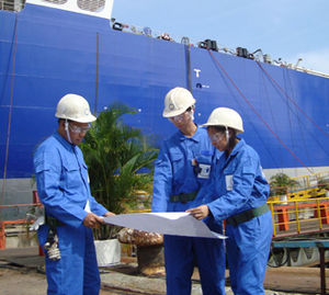 Marine engineering - Marine engineers reviewing ship plans