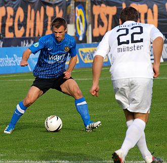 Martin Forkel - Forkel (left), playing for 1. FC Saarbrücken takes on Patrick Huckle of Preußen Münster