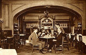António Botto - (Left to right): Unknown man, Raul Leal, António Botto, Augusto Ferreira Gomes (standing), Fernando Pessoa at the Café Martinho da Arcada, Lisboa, 1928