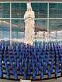 Mary Statue with candles in the Chapel of Light, Attleboro USA.jpg