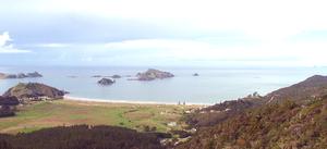 Matauri Bay - Panorama of Matauri Bay. The Cavalli Islands are further to the left.