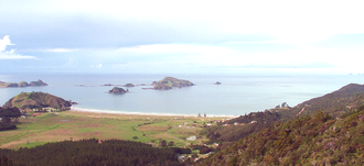 Matauri Bay - Panorama of Matauri Bay. The Cavalli Islands are further to the left.