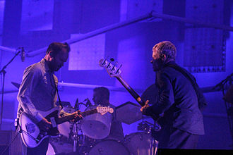 Nigel Godrich - Godrich (left), Joey Waronker (rear) and Flea performing with Atoms for Peace in 2014