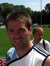 A man wearing a sleeveless football training shirt