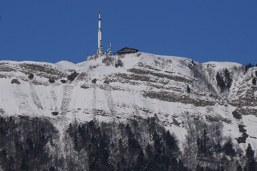 Mont Rond 1533, as seen from city center of Gex 600 m. The chalet and the telecommunication tower