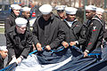 More than 100 Sailors from Navy Region Midwest, Navy Recruiting Chicago and Naval Station Great Lakes, Ill., gather to hold an American flag before opening day ceremonies for the Chicago White Sox's major 080407-N-IK959-027.jpg