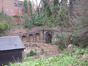 Highgate tube station - North end of the station cutting with tunnel portals. The red brick building in the background houses the exit at the top of the cutting.