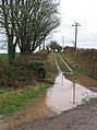 Muddy track to the trig point - geograph.org.uk - 659663.jpg