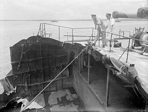 Japanese cruiser Myōkō - Two British naval officers examine what is left of the Myōkō's stern.